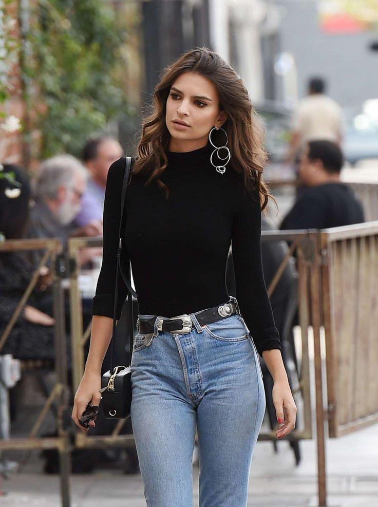 Emily Ratajkowski wears a black turtleneck with mom jeans