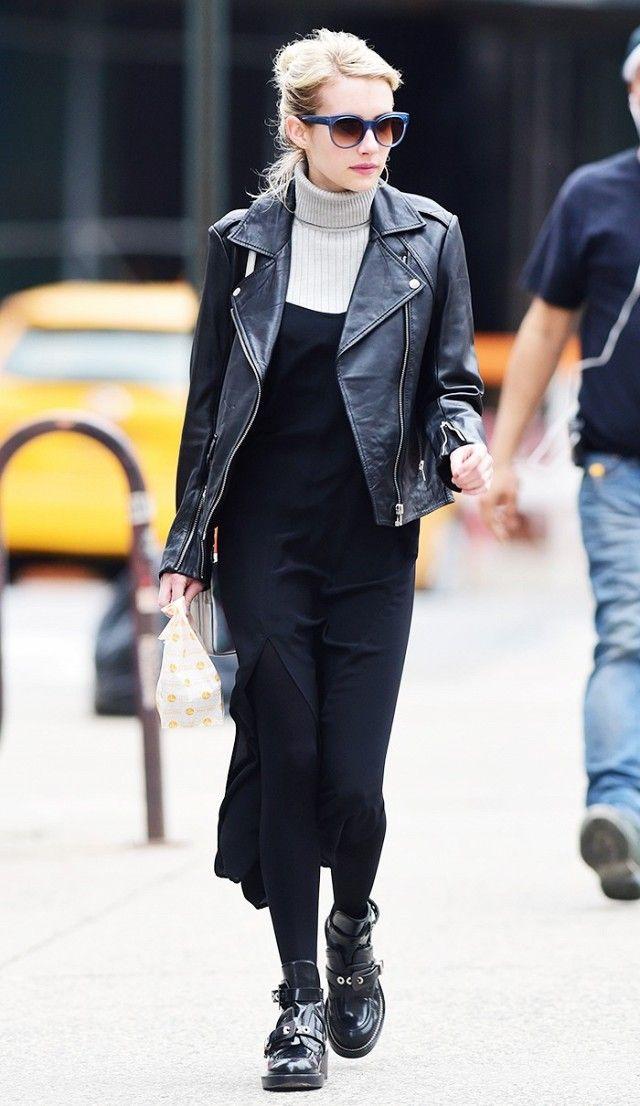 Emma Roberts wearing a turtleneck underneath a black dress