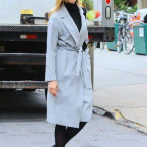 Karlie Kloss wears black turtleneck with trench coat