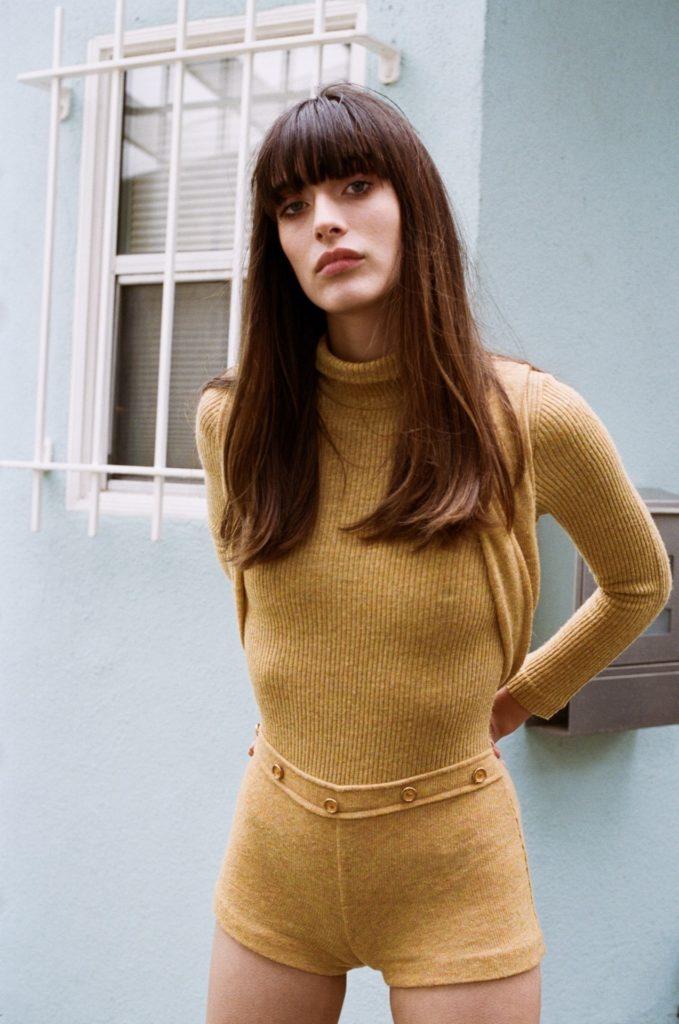 Louise Follain in yellow body suit