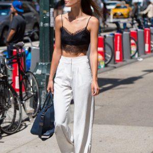 Sadie Newman wearing white pants and black crop top (3)
