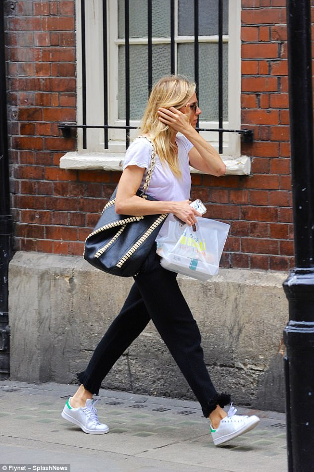 Sienna Miller walking in London in sweat pants and casual tshirt