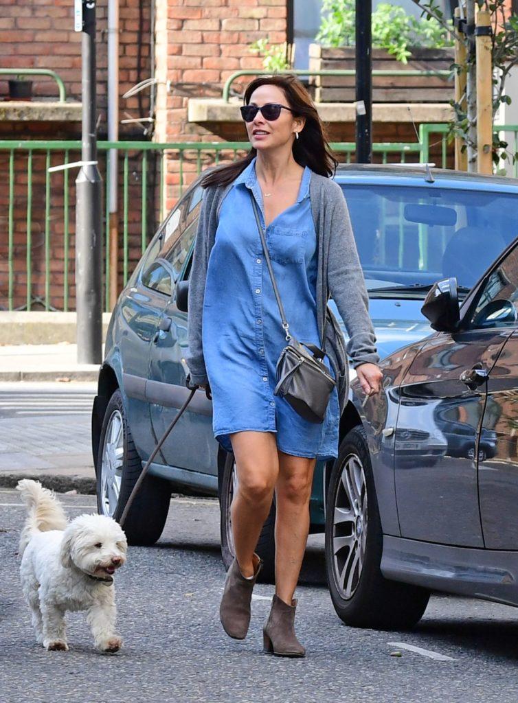 Natalie Imbruglia in a blue dress walking her dog on September 3, 2017