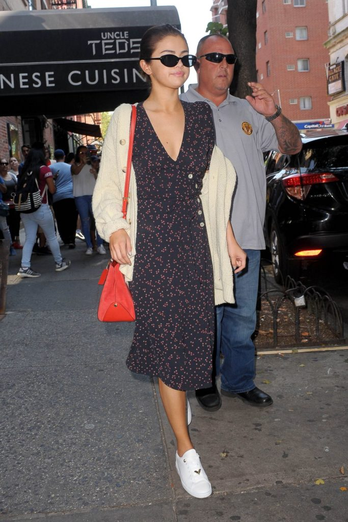 Selena Gomez in a dress and sneakers in NYC