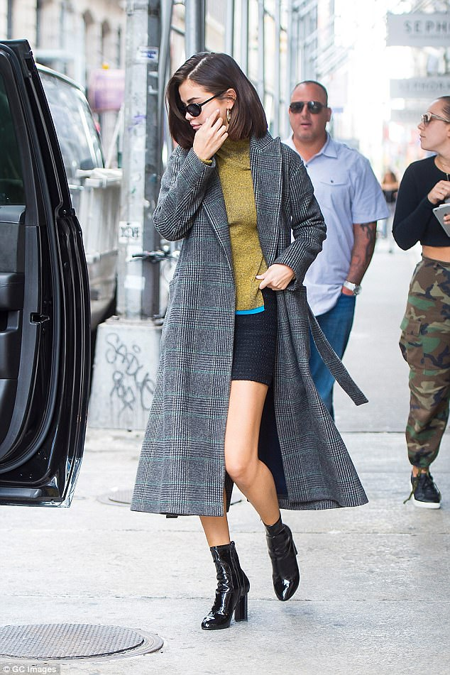 Selena Gomez in trench coat and shiny shoes in NYC