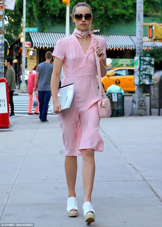 Suki Waterhouse wearing checkered pink dress and white shoes in NYC